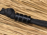 Medium Black Micarta Lanyard Bead With Three Grooves and a Free Paracord Lanyard