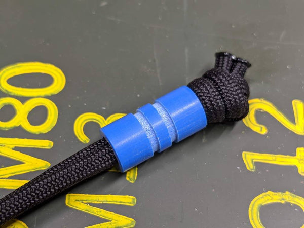 Wide Edge Medium Blue G10 Bead With 2 Grooves and a Free Paracord Lanyard