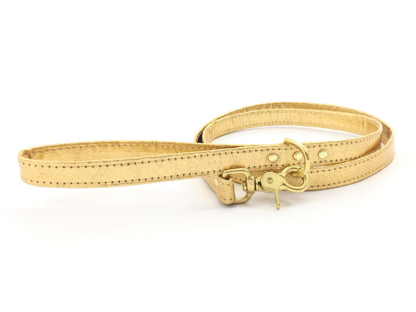 Fancy gold dog lead in Pinatex vegan leather with solid brass hardware