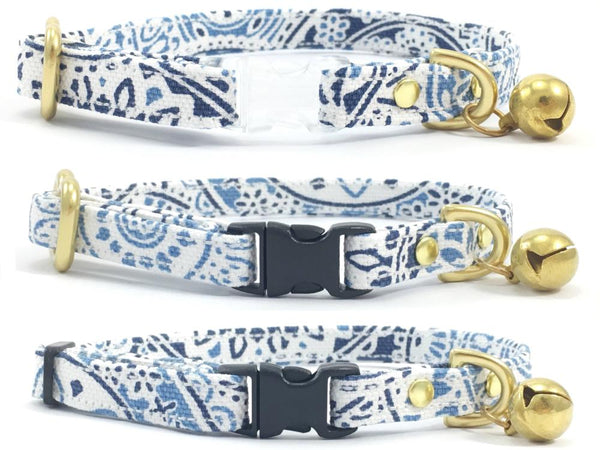Luxury designer blue & white patterned cotton fabric breakaway safety cat collars with solid brass bell, made in London by Noggins & Binkles