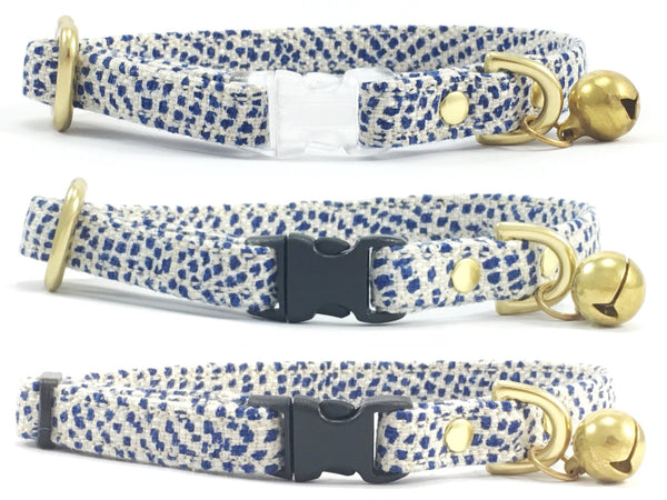 Luxury blue polka dot pattern linen/cotton fabric breakaway safety cat collars with a choice of black or transparent breakaway safety buckle and solid brass or black sliders, all with a solid brass bell