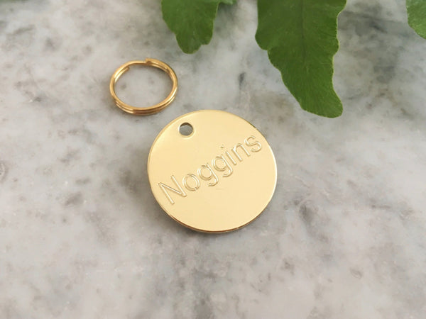 Brass dog or puppy ID tag in luxury solid brass engraved with personalised text in the UK