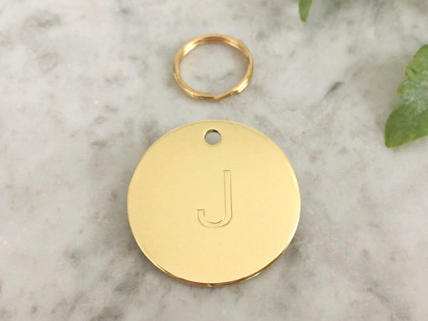 Cat ID tag with initial in luxury solid brass, engraved in the UK