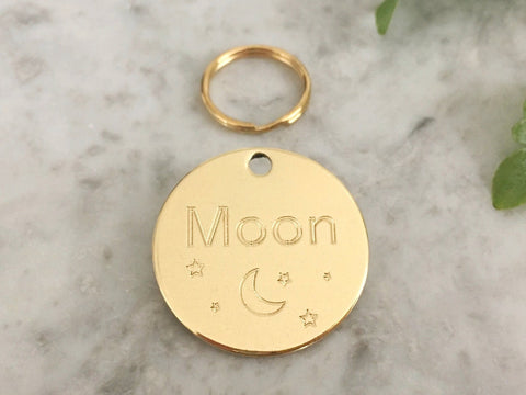 Cat ID tag with unique moon and star design, made from luxury brass. Engraved in the UK.