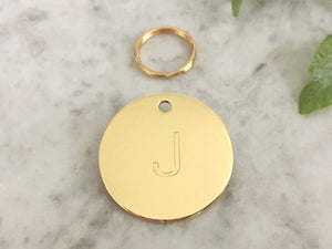 Dog ID tag with initial in luxury solid brass, suitable for dogs and puppies, engraved in the UK.