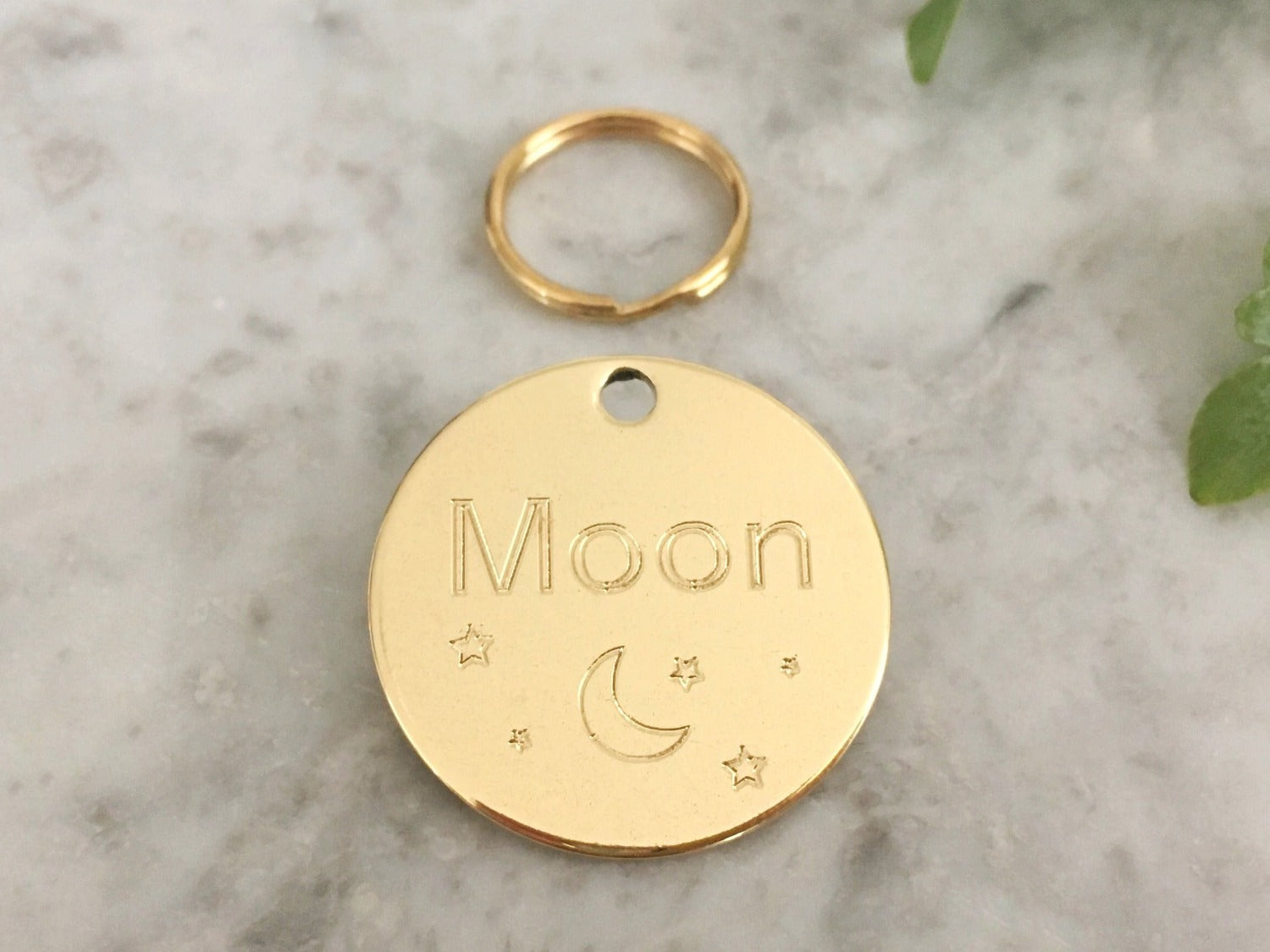 Dog ID tag with unique moon and stars design in luxury solid brass. Personalised and engraved in the UK.