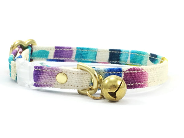 Funky cat collar with bell in unique cotton fabric featuring blue, pink, turquoise, yellow and purple