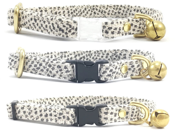 luxury stylish grey polka dot linen and cotton fabric breakaway safety cat collar with solid brass bell, can be customised with a choice of transparent or black breakaway buckle and choice of solid brass or black slider, made by Noggins & Binkles
