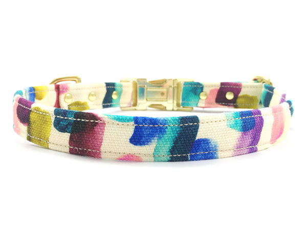Dog collar in a yellow, pink, green, blue, turquoise and purple patterned luxury cotton with brass buckle and solid brass hardware