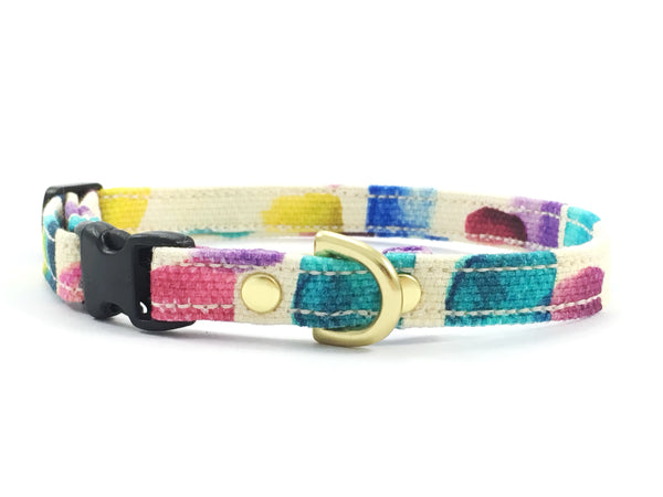 Extra small/miniature dog collar in a yellow, pink, green, blue, turquoise and purple patterned luxury cotton with brass hardware