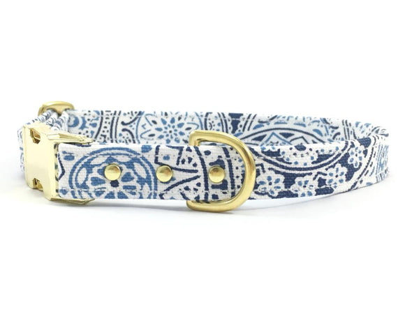 Dog collar in designer blue and white patterned cotton with brass buckle and solid brass rivets and hardware, made in London in the UK