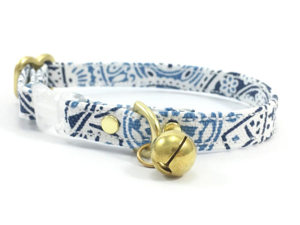 Breakaway safety cat collar in unique blue and white summer patterned cotton with solid brass bell, made in London in the UK