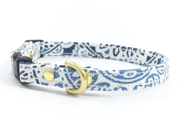 Miniature/toy dog collar in luxury blue and white patterned cotton with black buckle and slider and solid brass hardware, made in London in the UK