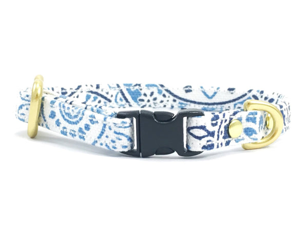 Designer miniature dog collar in blue and white patterned cotton fabric with black buckle and solid brass hardware, suitable for miniature dachshunds, Maltese and chihuahuas