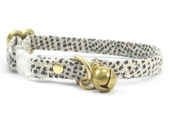 Grey polka dot breakaway safety cotton cat collar with transparent buckle made in London in the UK