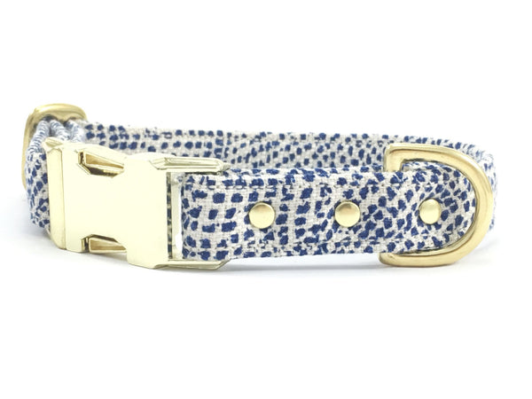 Blue polka dot dog collar with brass buckle & solid brass d ring and rivets, made in the UK by Noggins & Binkles