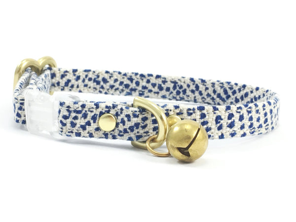 Stylish blue polka dot linen/cotton fabric designer breakaway safety cat collar with bell, made in London by Noggins & Binkles