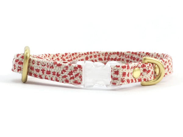 Luxury red polka dot miniature dog collar with solid brass hardware, made in the UK by Noggins & Binkles