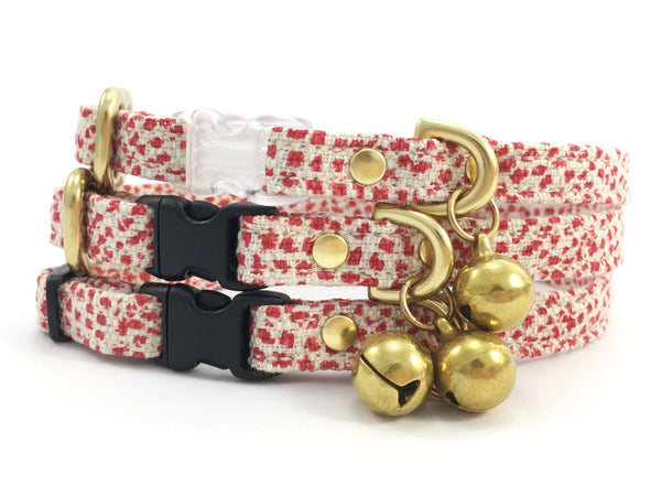 Christmas cat collars in luxury red polka dot cotton and linen fabric with buckle and solid brass bell, by Noggins & Binkles