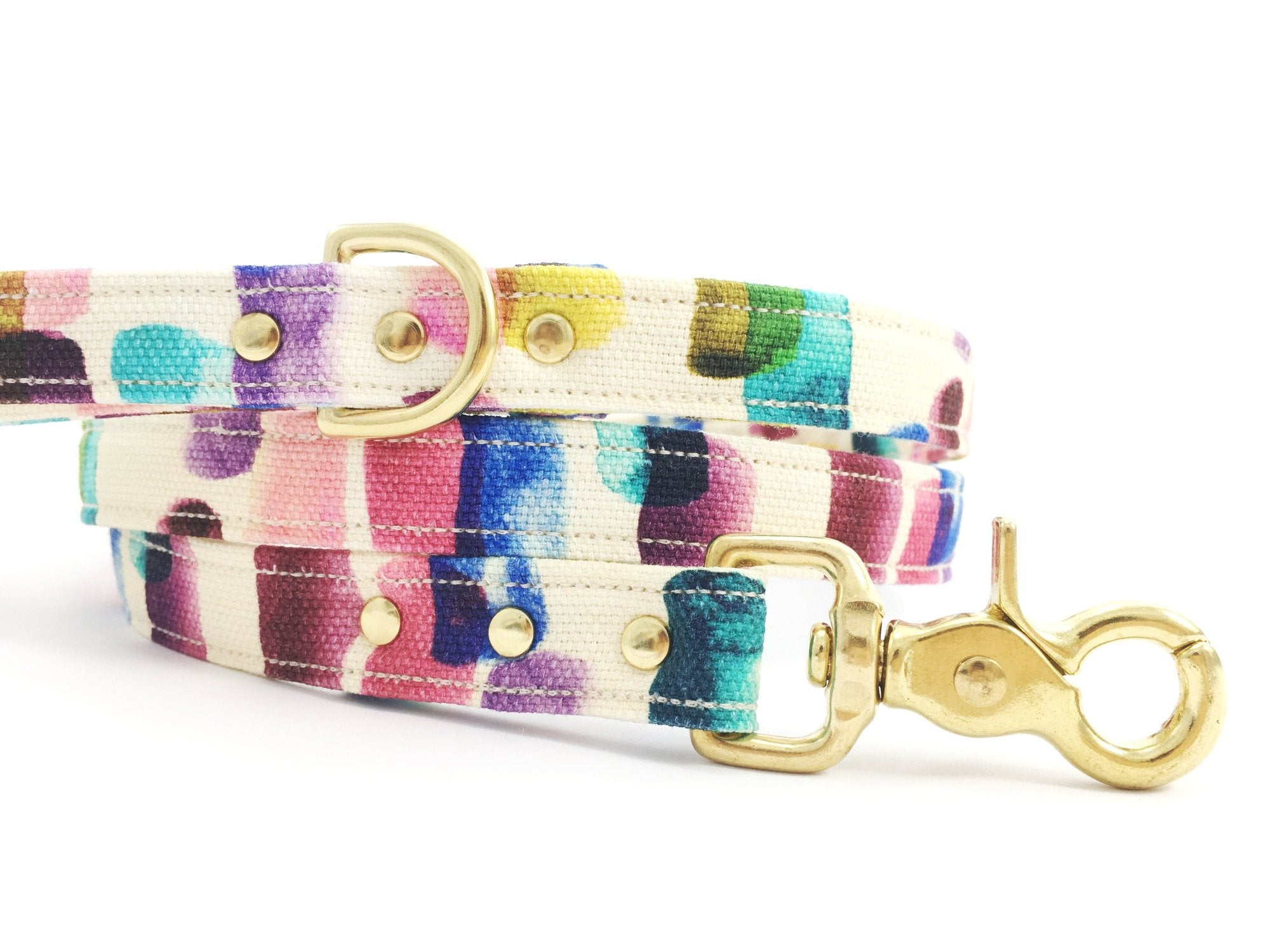 luxury cotton dog lead in blue, green, purple, yellow, pink and turquoise fabric with solid brass trigger snap hook, d ring and rivets, by Noggins & Binkles