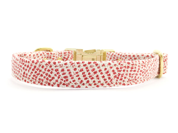 Red polka dot dog collar in luxury cotton and linen fabric with gold brass hardware, made in the UK by Noggins & Binkles