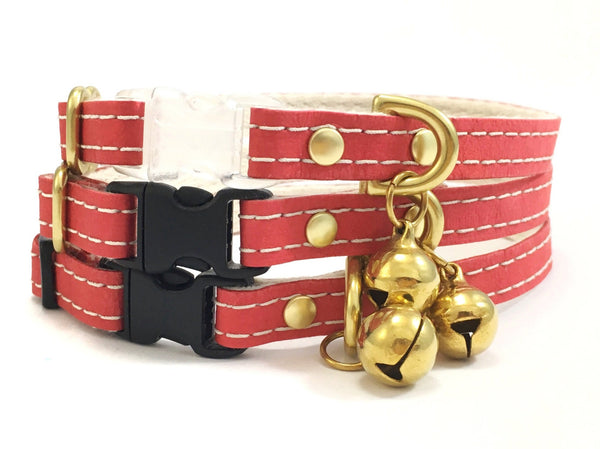 Luxury red vegan leather cat collar with unique contrasting stitching, breakaway safety buckle and brass bell