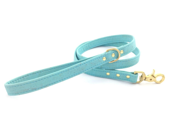 Turquoise dog lead in unique vegan cork leather with luxury brass gold hardware, made in the UK