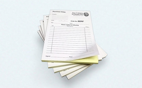 Two part carbonless forms padded into booklets.
