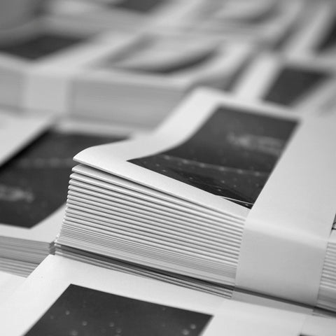 Stack of black and white booklets.