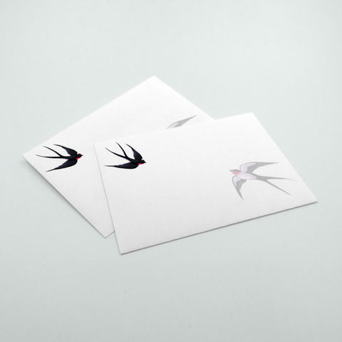 A7 envelopes printed full color with flying bird in front.
