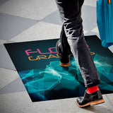 Person walking over full color printed large adhesive vinyl floor graphic.