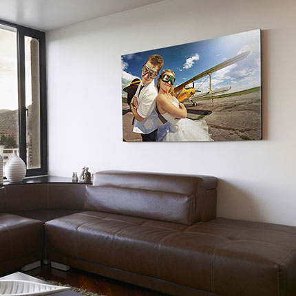 Mounted canvas print on living room wall