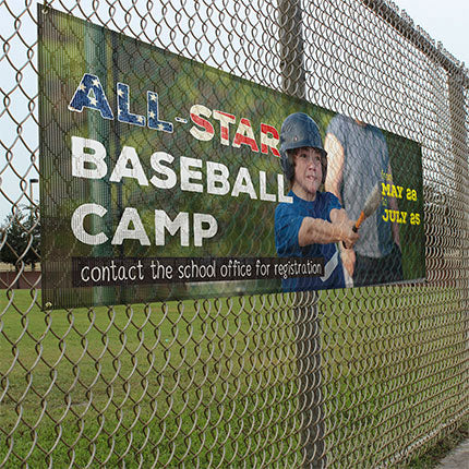 Full color baseball camp mesh banner mounted on fence.
