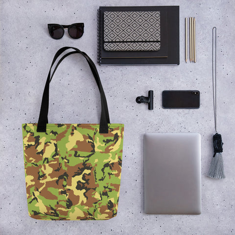 All-over printed tote bag with camo pattern surrounded by items.