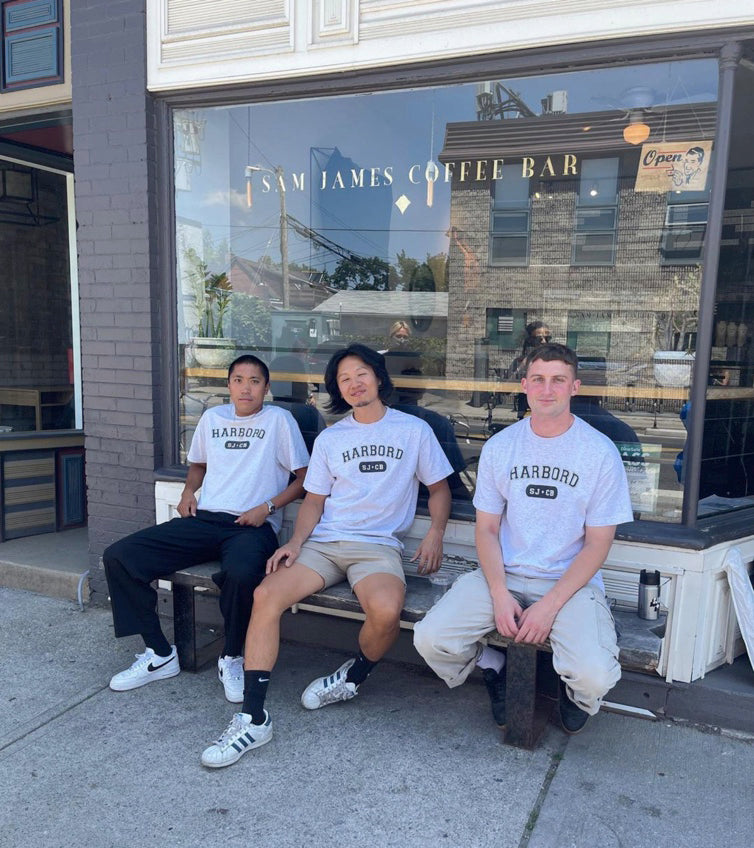 Sam James Coffee Bar Harbord Location with staff on the front bench wearing Harbord T-Shirts
