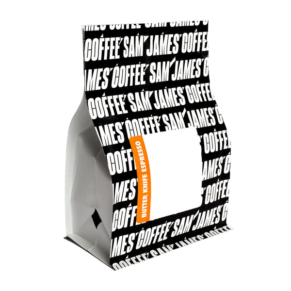 Sam James Coffee Butterknife espresso bag with allover, black and white logo print.