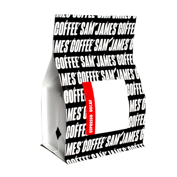 Sam James Coffee decaf espresso bag with allover, black and white logo print.