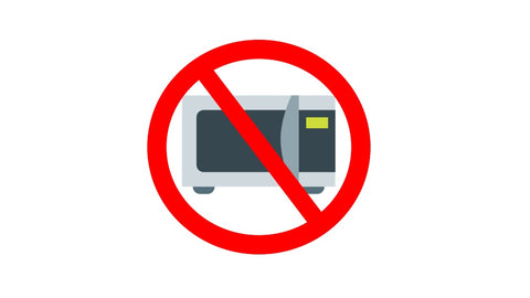 A no sign over a microwave oven symbolizing to avoid using a microwave for health purposes.