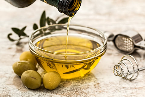 Olive Oil representing a healthy way to cook.
