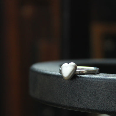 Solid silver pebble heart on a silver ring
