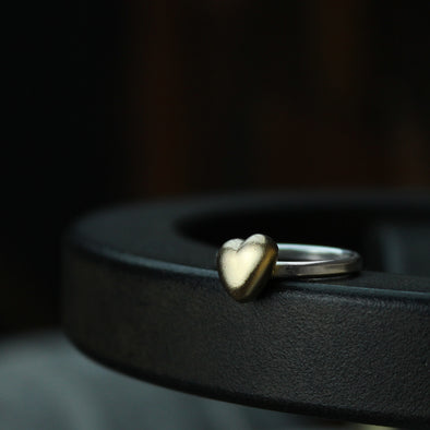 Solid 9ct gold heart on a silver ring
