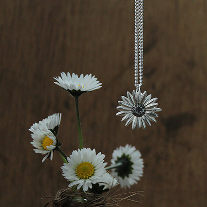 Solid silver daisy charm