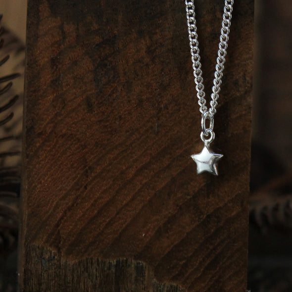 Solid silver star charm
