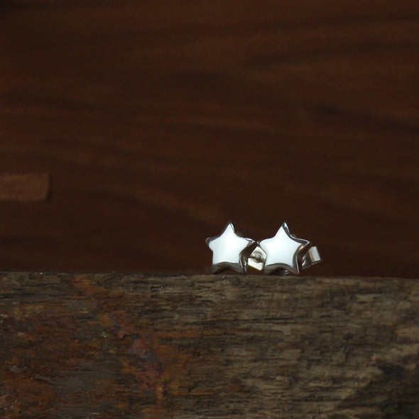 Solid silver star studs