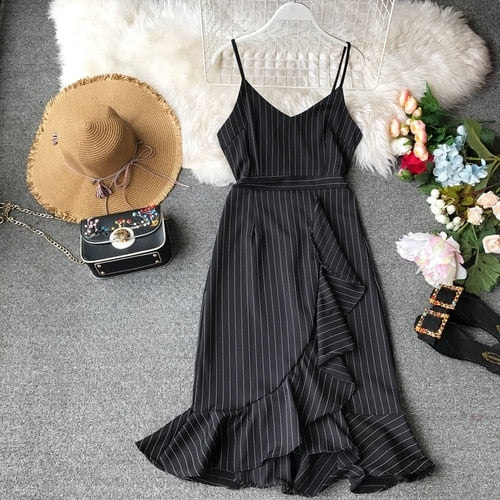 Sleeveless V-necktie dress with irregular stripes and lotus edges