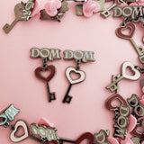 DOM Kinked Love enamel pin