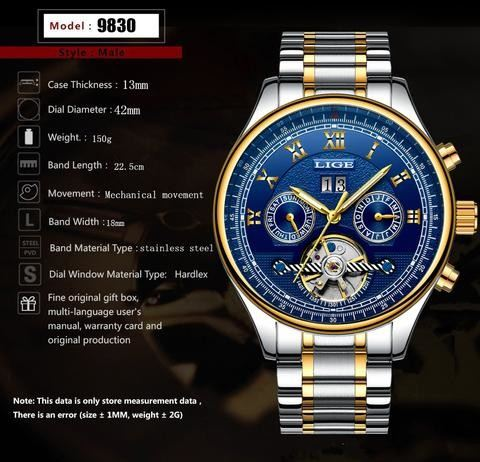 a black and gold clock in the middle of a watch