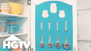 Save space in your utensil drawer by storing measuring cups on the back of a cabinet