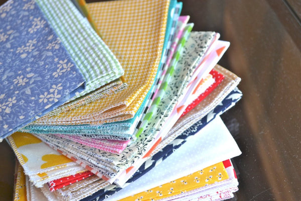 bargain stack of cloth napkins with variety of patterns