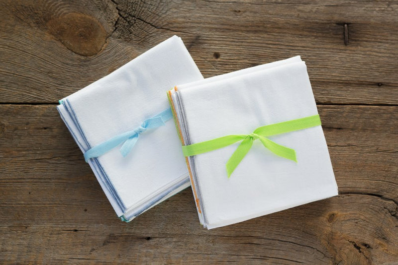 white flour sack towel squares as gifts